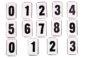 Numbers on metal plates font from zero to nine isolated on white background