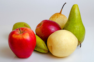 Apples and pears on a gray background.