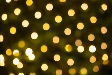 Yellow and orange holiday festive bokeh. Christmas Abstract background
