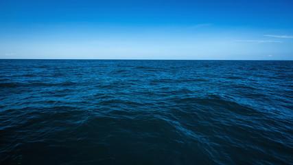 Poster Mer / Ocean The vast ocean in the winter, Dark and deep ocean with blue sky