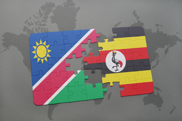 puzzle with the national flag of namibia and uganda on a world map