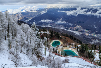 Winter snowy mountain forest and peaks with two artificial water reservoirs beautiful scenery