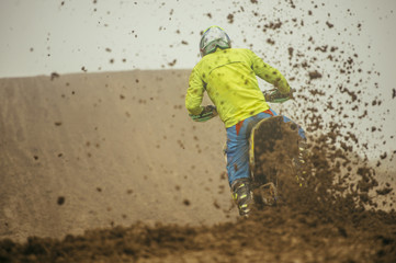 Motocross motorbike sprinkling mud