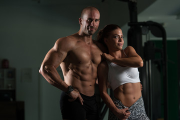 Young Couple Posing In The Gym
