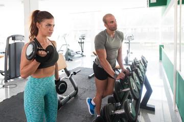 Coach Helping Grl In Gym