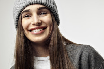 Beautiful pretty young woman smiling, close-up portrait. Winter mood. Happy face emotions.