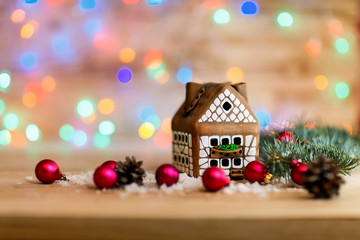 beautiful gingerbread house and Christmas decorations on festive