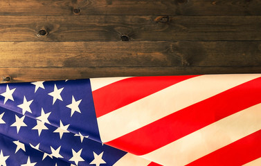 American flag lying on dark wooden background