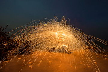 Burning steel wool spinned on the beach