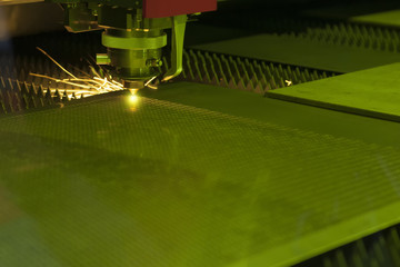 The laser cutter machine while cutting the sheet metal  with the