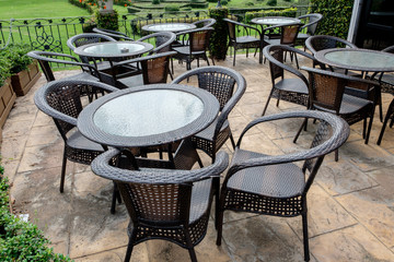 Chairs and tables of a restaurant seating outside