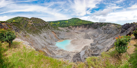 Panoramic view of Tangkuban Perahu crater, showing beautiful and huge mountain crater, at the morning,illuminated by sunlight.  There also a blue sky and beautiful cloud