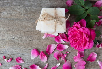 Spa concept with white coconut soap and beautiful rose flowers o