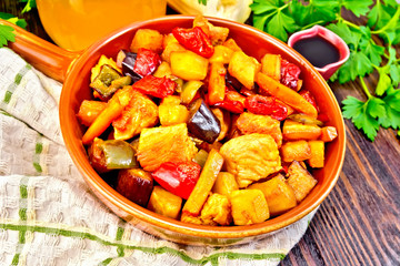 Roast with vegetables and honey in pan on board