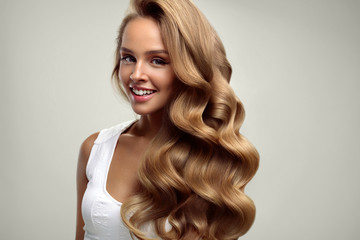 Beauty. Beautiful Woman With Long Blonde Curly Hair. Hairstyle