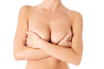 Topless woman covering her breast