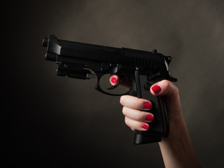 Pistol in female arm