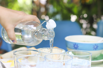 Stock Photo:.Pouring water from bottle into glass