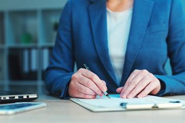 Business agreement signing, businesswoman handwriting signature