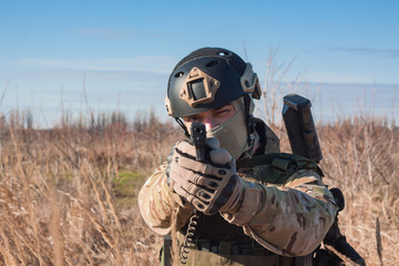 close up airsoft soldier portrait with pistol
