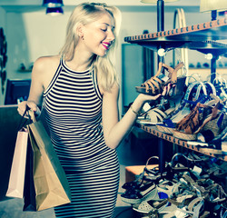 Glad  woman shopping pair of new shoes