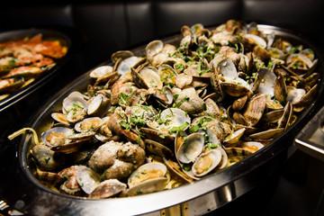 Mussels lie on big steel dish