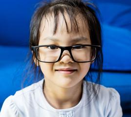 Asian girl look nerdy wearing glasses