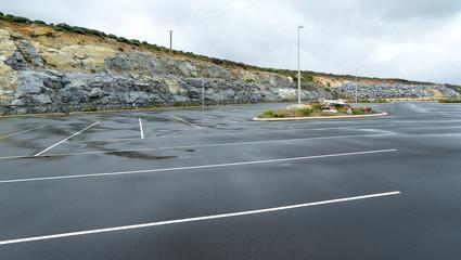 Wet asphalt road at Augusta Boat Harbour ,Western Australia .