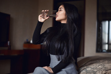 Portrait of elegant beautiful business woman in hotel room