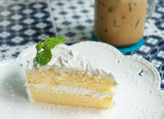 coconut cake on white dish, vintage tone
