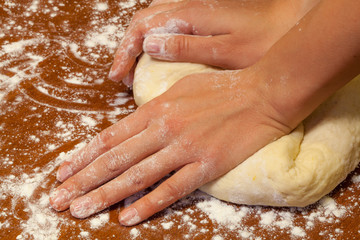 Knead the dough on the table, Russia
