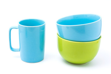 light blue coffee cup and light blue bowl and green bowl