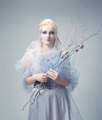 blonde in a white dress with blue makeup. The Snow Queen.