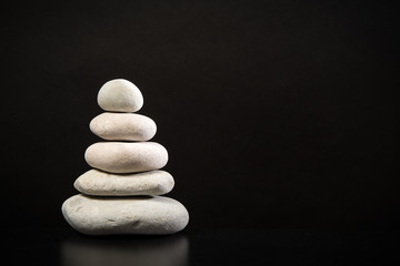 Pile of white stones on a black background with room for text