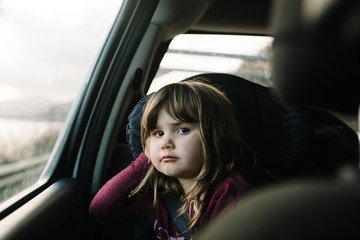 Portrait of girl in car seat