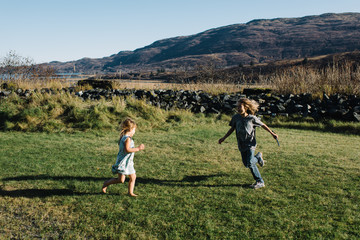 Two children playing in field
