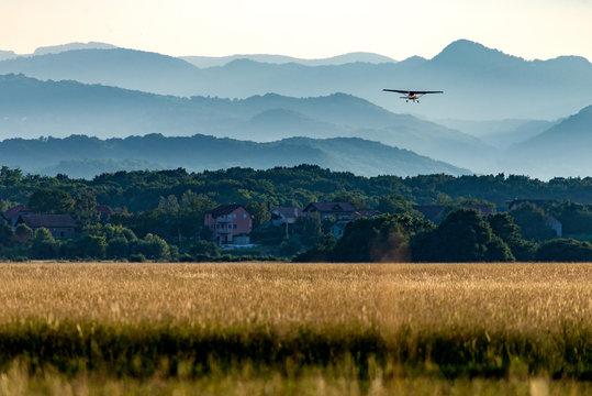 Small airplane lifting off a grass airfield near Zagreb, Croatia.