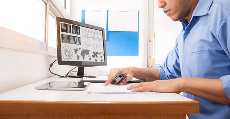 Doctor working with computer at desk in the hospital