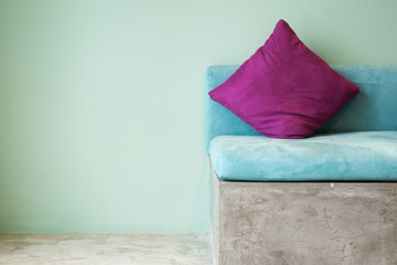 purple pillow on aqua sofa,interior concept