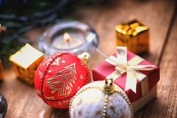 Christmas balls, gift boxes and candle