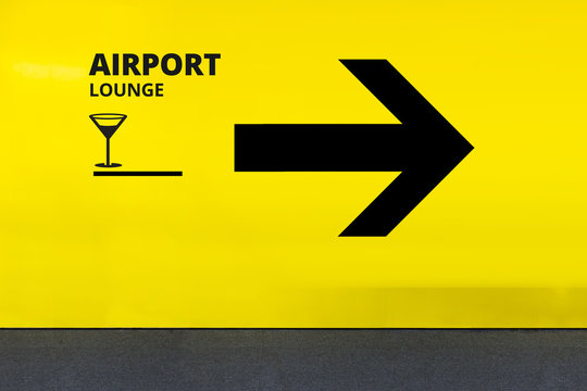 Airport Sign With Airport Lounge Icon and Arrow at the Terminal