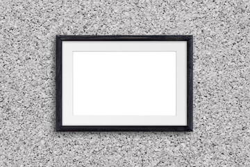 Black natural wooden frame on cork textured wall, interior decor mock up