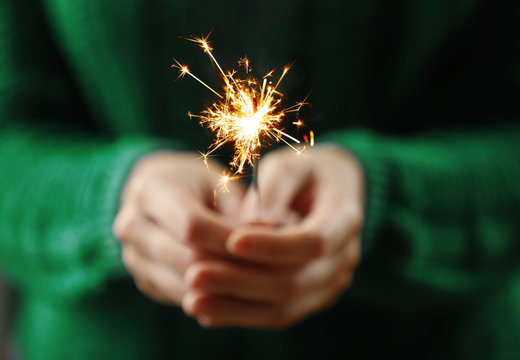 Close up view of hands with sparkler