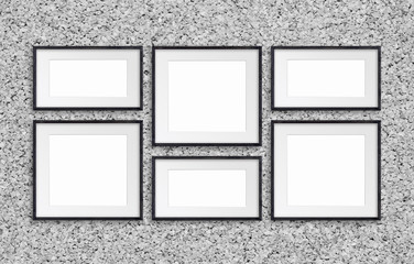 Collage of black wooden frames on cork textured wall, gallery style mockup
