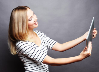 young teenager girl taking selfie with digital tablet