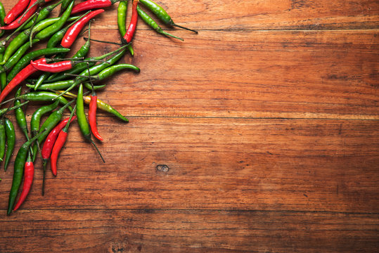 Red and green chilli on wooden table background. food concept, Top view
