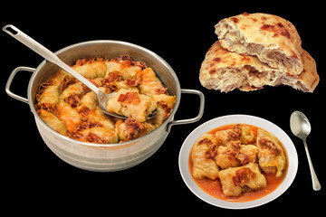 Sauce Pot And Plate Of Cabbage Rolls Stuffed With Minced Meat And Pitta Bread Isolated On Black Background