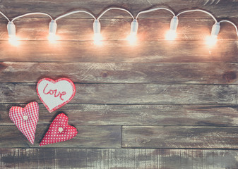 valentine wooden textured background with light garland