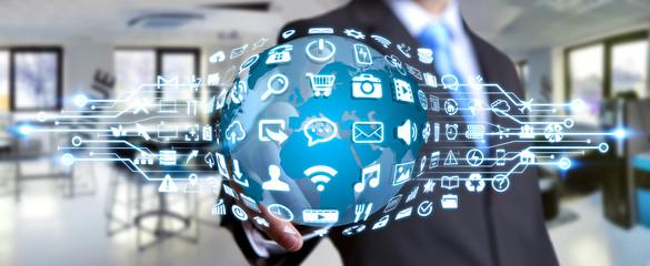Businessman using digital world with web icons