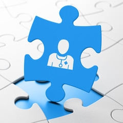 Healthcare concept: Doctor on puzzle background
